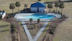 110 Nautical Club pool with landscaping resized (1)